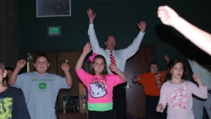 State Senator Ward helps students by participating in the demonstration.