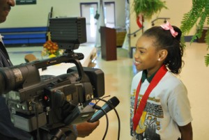 Gilliard elementary student, Taijah Bennett, gives an interview following the WCFO Program demonstration.